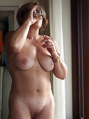 Amazing MILF playing with her hooters