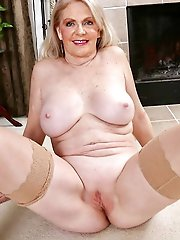 Lusty older lady taking off her underwear