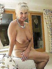 Raunchy older dame exposing her sexy lines on picture