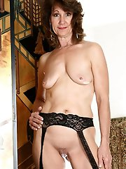 Juiciest experienced mama posing undressed