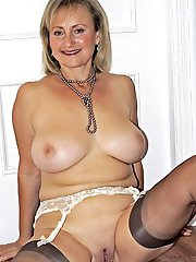 Raunchy older chick playing alone